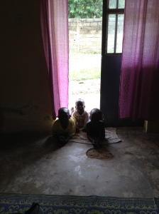 Some of my neighbor children hanging out in my doorway