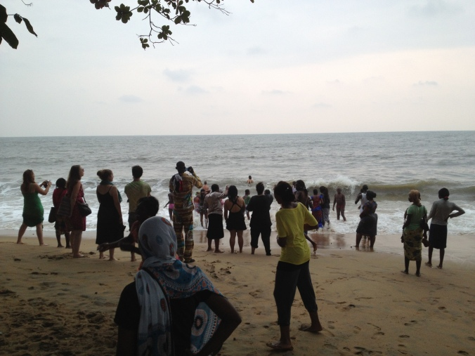 Volunteers, counterparts, and girls on the beach in Kribi.