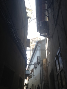 The Catholic cathedral, peaking out from above a Stone Town alleyway.